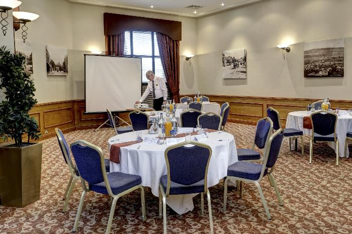 Delamere Suite at Forest Hills Hotel set up Cabaret Style with projector and screen