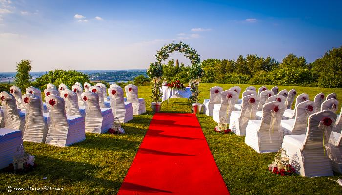 Red Carpet and Civil Ceremony set up outside on the hill, looking over the Estuary